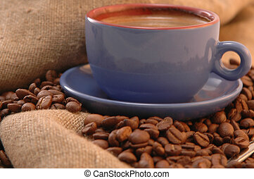 coffee beans and cup with coffee - coffee beans cup with...