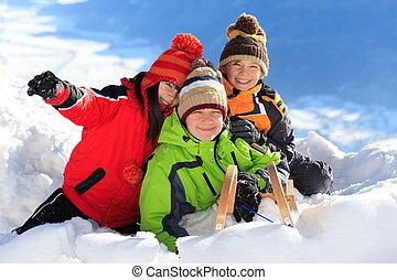 Happy children in snow - Three happy children playing on...