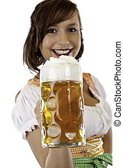 Smiling woman with dirndl  holds Oktoberfest beer stein