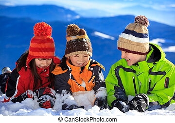 Children playing in snow - Three children playing in winter...