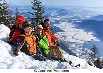 Family on snowy mountain