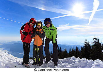 Children in ski clothes - Three happy children with ski...