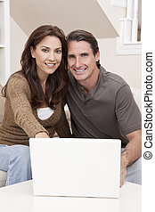 Man & Woman Couple Using Laptop Computer At Home