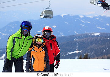 Kids on mountaintop snow - Group of skiers on mountain side...
