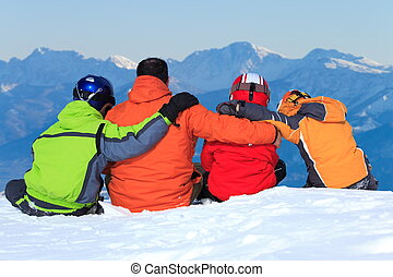 Family on mountain slope - Children and father huddled...