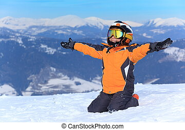 Young skier on snowy mountain