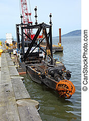 Industrial dredging barge. - Industrial dredging mechanism,...