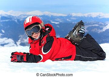 Happy girl in ski helmet