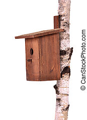 Wooden birdhouse on a stem over white