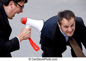 megaphone - businessman screaming loudly in a megaphone at...