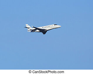 Small passenger airplane in blue sky
