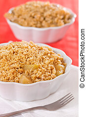 Apple crumble dessert in a bowl with a fork on the side...