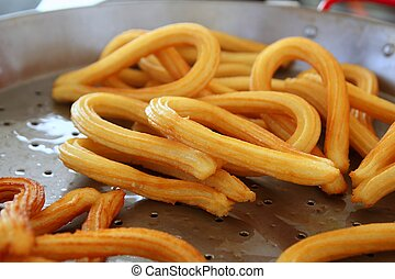 churros fried with oil unhealthy food - churros fried with...