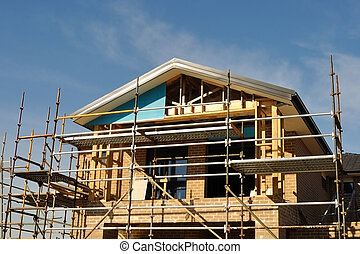 House front in scaffolds - Multi-storey domestic house in...