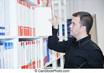 male adult in archive library - business man male adult in...