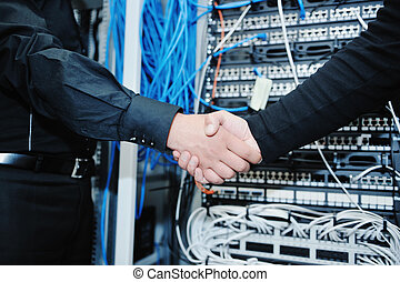 it engineer in network server room solving problems and give...