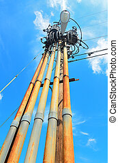 gritty light pole with transformers and electric cable