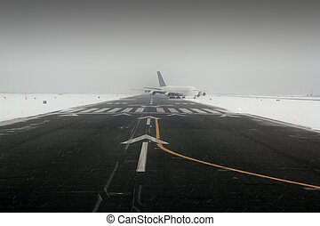 airplane wing aircraft landing in snow winter runway -...