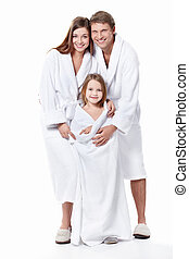 Family - Young family with a child in overalls on a white...