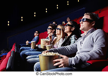 Cinema - Young people watch movies in cinema
