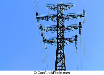 electric power transmission towers against the blue sky