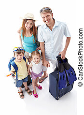 Vacation - A happy family going on holiday on a white...