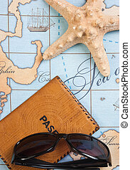 passport and sunglasses on map - passport and sunglasses on...