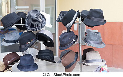 Many Styles of Hats on an Outdoor Rack - An outdoor market...