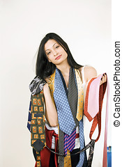 Shop girl with ties - Pretty shop girl carrying colorful...