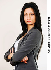 Tough female boss - Portrait of tough female boss in gray...