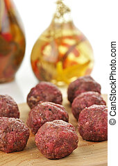 meatballs - raw meatballs on a cutting board , close up
