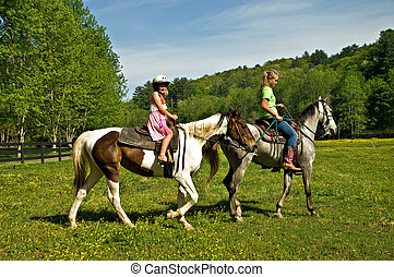 Girls Riding Horses - A young girl getting a horseback...
