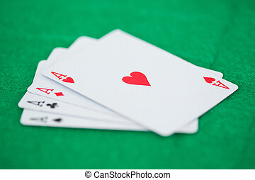 Games card aces on a green playmats - Poker cards on a green...