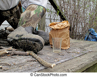 Moonshine - Evidence of moonshine in a paper bag on the side...