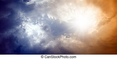 Dramatic sky with bright sun
