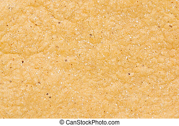 Tortilla Chip - Close-up detail texture of a corn tortilla...