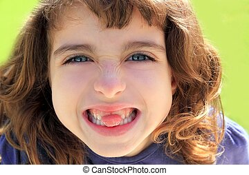 indented girl sticking tongue between teeth - indented...