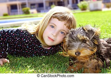 dog pet and littl girl portrait on garden grass park - dog...