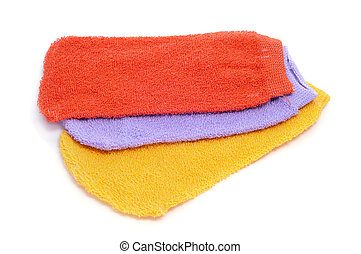 washing mitts - some washing mitts of different colors on a...