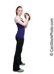 Woman Baseball Player - A beautiful woman pitcher getting...