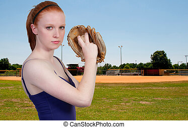 Woman Baseball Player - A beautiful woman pitcher getting...
