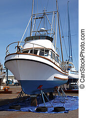 Boat repairs, Astoria OR. - Boat on stands to be serviced...