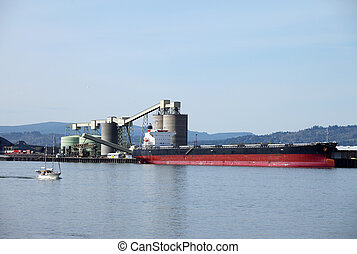 Cargo ships maritime transportation - A cargo ship loading...