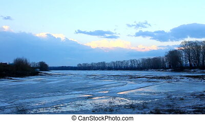 spring lake landscape with melting ice