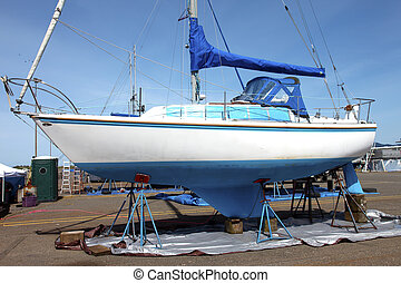 Boat repairs, Astoria OR - Boat on stands to be serviced and...