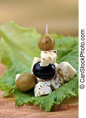 feta cheese and olives close up