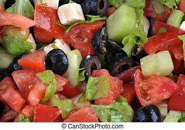 salat with feta cheese and fresh vegetables  close up