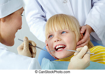 Dental checkup - Image of little girl having her teeth...