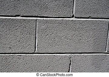 Grey brick wall background close up - macro of grey (gray)...