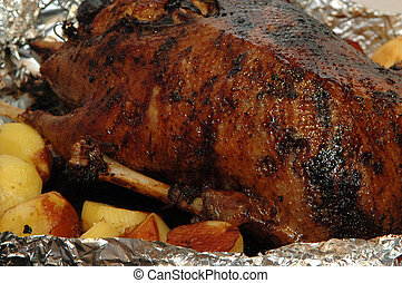 big roasted chicken with potato